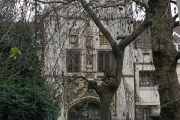 Gate of Christs College seen across Great St Andrew's churchyard