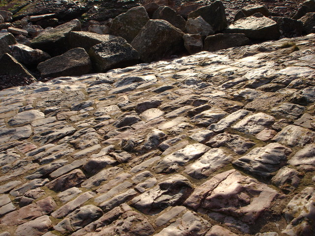 Glowing cobblestones slope down to the beach