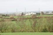 View across pasture land to Fferm Hafodol Newydd