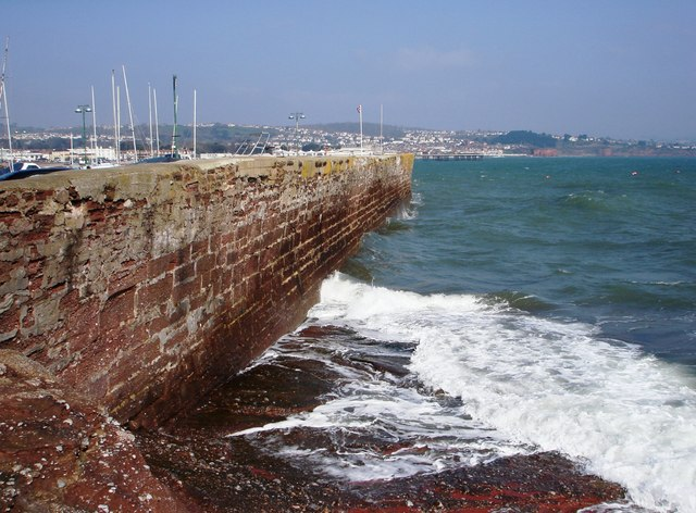 Paignton outer harbour wall, pier in the distance