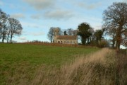 Field near Bessingham with St Mary church in the background