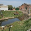Pumping Station at Thorpe Tilney Dales with nesting Swans