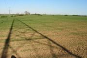 Pylon shadow on arable land.