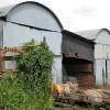 Corrugated barns near Burton Mill