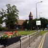 Clock at road junction near St Mary's Church Partington