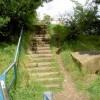 Steps on footpath.