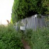 Footpath adjacent to sewage works.