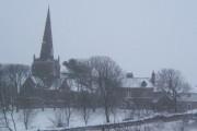 Millom church during a snow fall