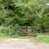 Gate into private woodland