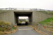 Bridge carrying the A55 over a lane to Caergeiliog from Ysbylldir
