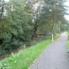 Footpath by stream through Herne Farm Estate