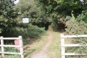 Entrance to path through woodland to north of Barnham