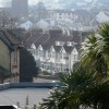 Houses and church tower, near Oldway mansion,  Paignton