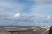 Cleveleys Beach and distant view of snow covered hills.