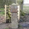Gatepost and benchmark at Gwysaney
