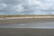 Walkers on Traeth Cymyran beach