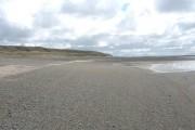Exposed shingle beach near the bar