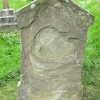 Badly weathered gravestone, St Michael's, Castle Frome