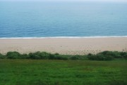 Looking down to the beach from the A379