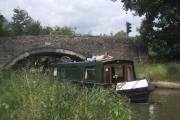 Narrowboat negotiating bridge 228 on the Oxford Canal