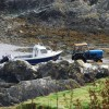 Fisherman launching boat at Porth Colmon