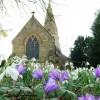 Lullington Church with spring flowers