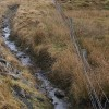 Fence and ditch beside the A970 north of Girlsta
