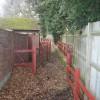 Red Metal fencing on footpath