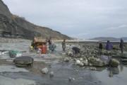 Men at work on the beach west of Lyme Regis