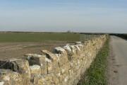 Lichen covered wall and farmland