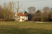 A view of Levens Green Farm as seen across the green