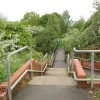 Steps down to the bridge crossing the River Dearne