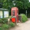 Telephone box by the parish notice board, Plymtree