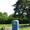 Blue toilet in churchyard