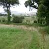 Looking across Dawlish Bridleway No 3 towards Aldens