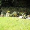 Graves in the churchyard at St John the Evangelist, Milton