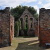 Looking through the remains of St. Giles Hospital.