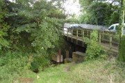 The Wool Brook goes under Sidford Road