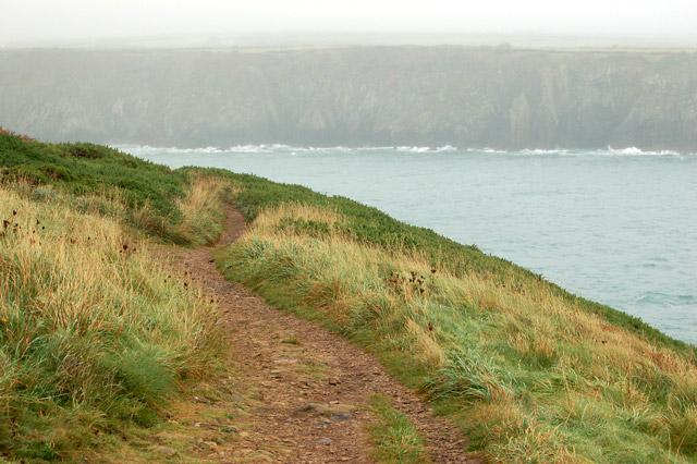 Misty view from the coastpath eastward across Caerfai Bay