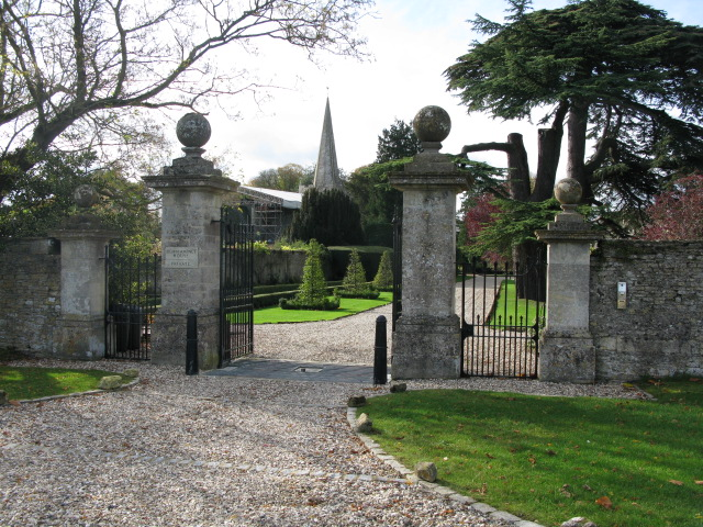 Spire of the church through the gates of Down Ampney House