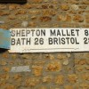 Road sign on house wall, Castle Cary, Somerset