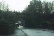 Railway line crosses the road north of Polsloe Bridge