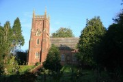 Sun on the church tower at Collaton St Mary