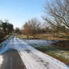 Approaching Heckingham on a snowy Norton Road