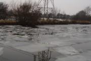 Pylon across frozen canal