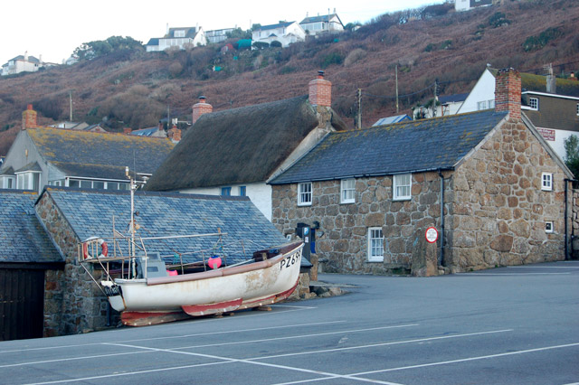 Fishing boat drawn up on a car park at Sennen Cove