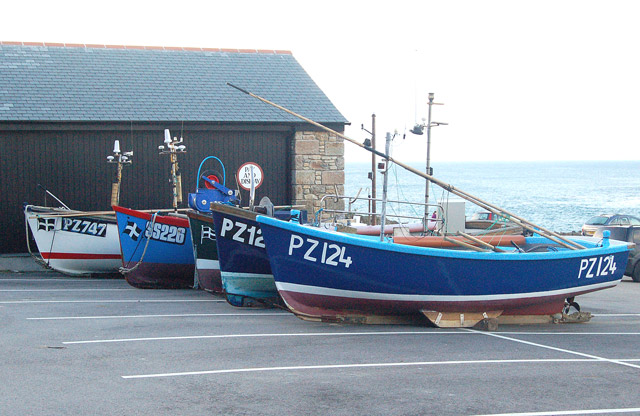 Fishing boats on a car park at Sennen Cove