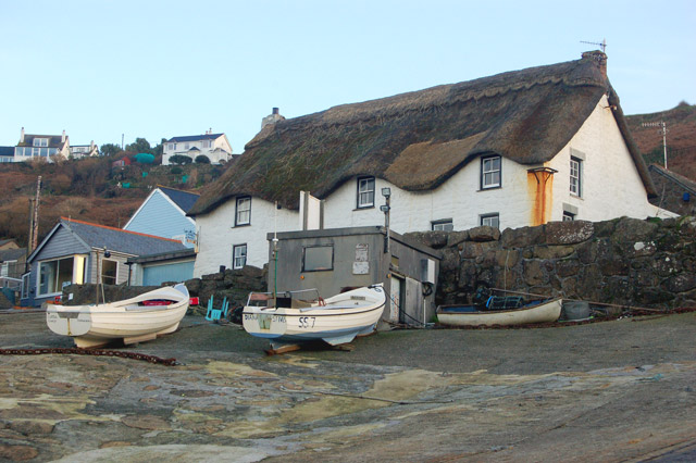 Thatched cottage and fishing boats at Sennen Cove