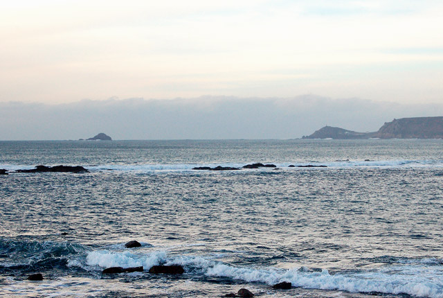 View over Cowloe rocks towards The Brisons island and Cape Cornwall