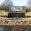 Brightly decorated flood defence works.